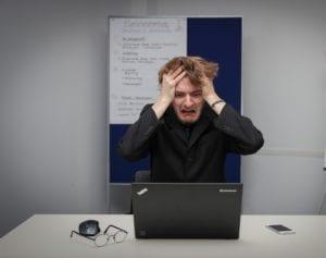 Frustrated IT Man-Photo by Sebastian Herrmann on Unsplash